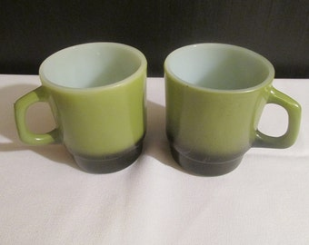 A Pair of Fire King Avocado and Black Stackable Coffee Mugs. / Cups