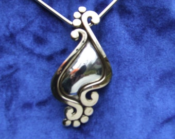 Sterling and bronze pendant on bronze choker