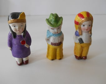 Cowboys and Indians! Just adorable Bisque Doll Set
