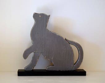 Cat wooden carved, weathered gray shown on a black base - original Creation