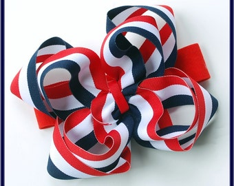 boutique double layered BIG navy and red PATRIOTIC STRIPES hair bow on a headband
