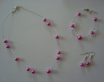 This jewelry set pink fuschia and crystal clear
