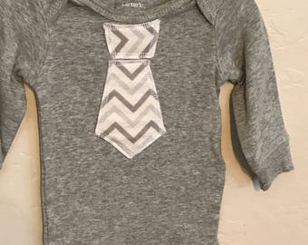 Onesie  with gray chevron tie 3 month