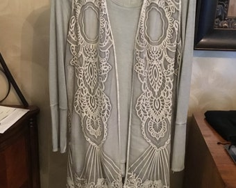 Long fringed vest, with long sleeve t-shirt. Size small/med
