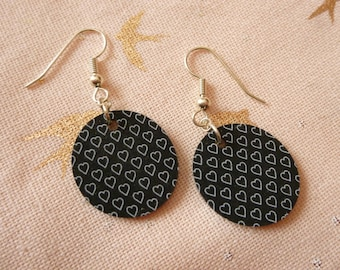 Oval plastic earrings crazy black, white outline hearts