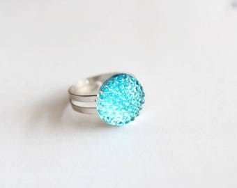 Ring with turquoise plastic pendant