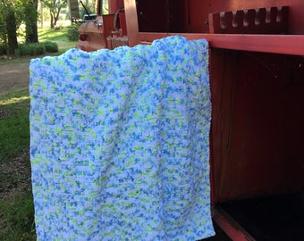 A one of a kind hand knit blanket for the one of a kind baby in your life.