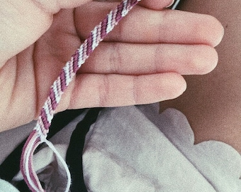 Knotted friendship ribbon in different colors