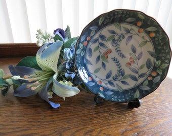 A pretty hand painted fluted plate