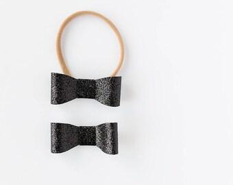 Black glitter vegan leather bow
