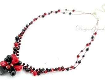 Red and black agate on silk necklace.