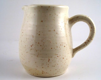Vintage cream and brown small pitcher or jug made in USA