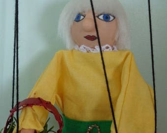 Gertrude marionette is going to market