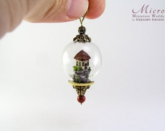 Miniature world pendant, miniature little houseon top of a hill under glass dome