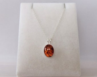 Sterling Silver 8 x 10mm Oval Amber Pendant Necklace.
