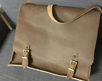 Stone oiled leather messenger bag.