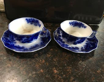 Antique flow blue china tea cup saucer