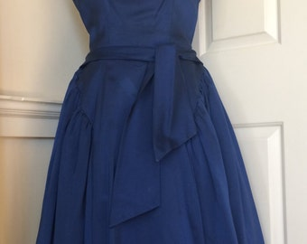 Beautiful vintage 1950s Mad Men-style midnight blue duchess satin dress