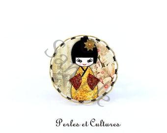 Kokeshi doll - black yellow flower cabochon ring