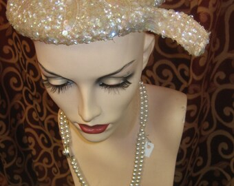 """1950's, 23"""" round, of pink champagne colored sequins"""