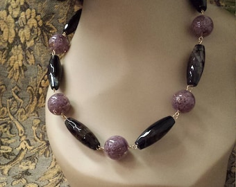 Black Onyx and purple artist glass beads