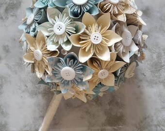Origami flower bridal wedding bouquet with handmade paper flowers in teal duck egg pastel cream neutral with button centre