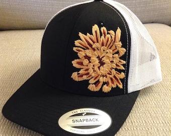 Hand stitched Golden Crysanthemum on black ball cap