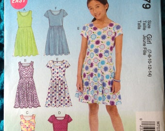 McCalls 7079, Girl's Pullover Dress, Back Cut Outs, Raised Waist, A-Line Dress, Flared Skirt, Easy New uncut sewing pattern