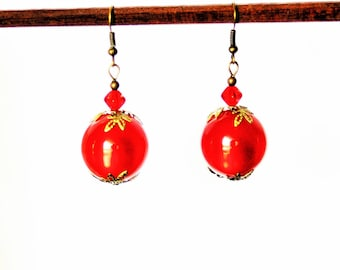 Earrings with bronze leaves and Siam red bead