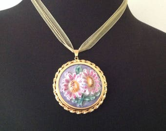 Retro series. Gold metal pendant and porcelain