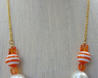 Chunky bright orange and white necklace and earring set
