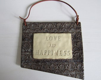 Love and Happiness Sign-Scallop pattern, faux suede hanger, charcoal glaze