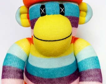 Cheeky Striped Sock Monkey with removable orange pom pom hat