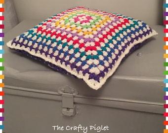 Rainbow granny square cushion