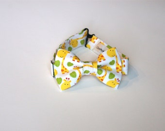 Bow Tie -White with Yellow Giraffes and Green Leaves.