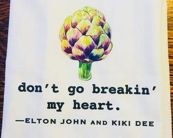 Funny tea towel: don't go breakin' my heart. Elton John and Kiki Dee