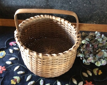 Primitive splint woven gathering basket