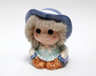 Vintage ceramic girl money-box with wool hair detail