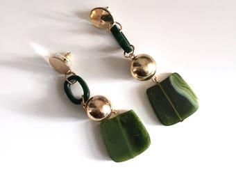Green dangle sphere earrings