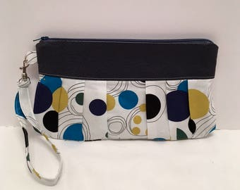 AK24- Compleat Clutch: in a fabulous circle print with pleated front, zipper closure and detatchable hand strap