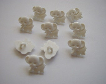 10 White Elephant Buttons