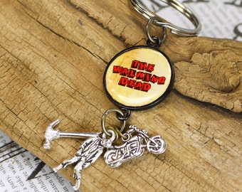Walking dead keychain, zombie keychain ,walking dead quote ,in bezel setting ,zombie and weapons inspired keychain