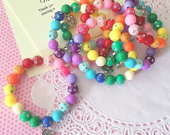 Luau party, rainbow hawaiian themed birthday party favor, beaded bracelet, jewelry. Comes with cards and organza bags, SET of 10.