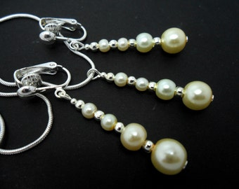 A hand made ivory colour glass  beads   necklace and  clip on earring set.
