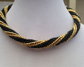 Beadwoven black and gold necklace and earrings.