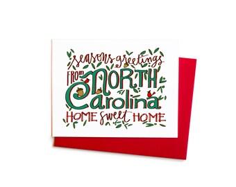 North Carolina Seasons Greetings, Single Greeting Card with Hand Typography and Cardinal