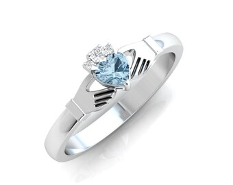 Blue topaz gemstone Claddagh ring, crafted in Ireland. Diamond and topaz claddagh ring. Irish ring.