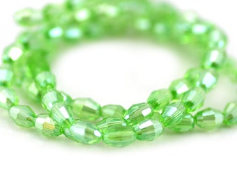 Chinese Crystal Faceted Barrel Rice Oval Bead Lime Green AB Finish 6x4mm