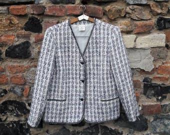 The pastel tartan Chanel style jacket