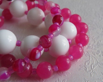 Stacking bracelet set. Three stretchy gemstone bracelets in white agate, pink chalcedony and pink striped agate.